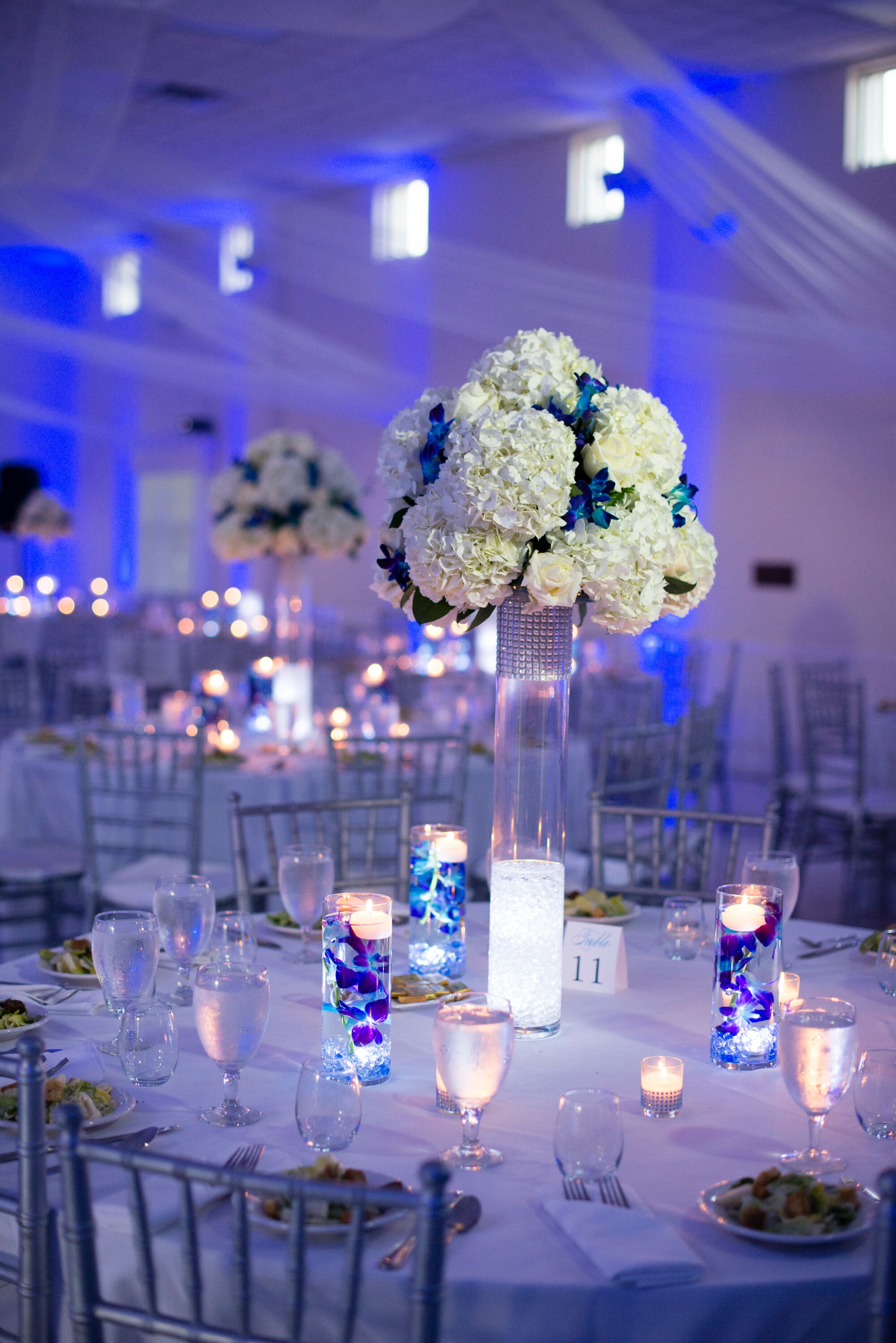 White And Silver Reception Decor With Blue Uplighting
