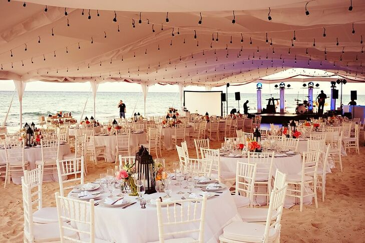 "Marta and Jose Luis's reception took place under a tent illuminated by bistro lights and lanterns at Le Reve Hotel and Spa in Playa del Carmen, Mexico. ""Everything was on the beach, so everyone took their shoes off and were comfortable. You could feel the ocean breeze,"" Marta says."