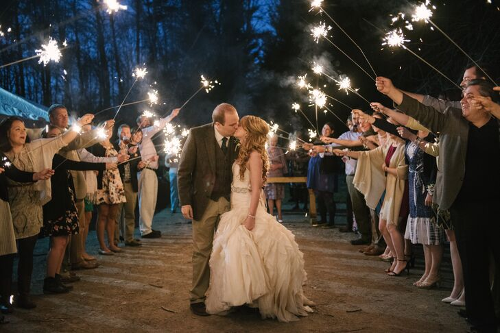 """I know sparklers may be overdone, but we weren't able to have confetti, balloons or sparklers at our venue during our first wedding,"" Taylor says. ""So the sparklers were a highlight for me."""