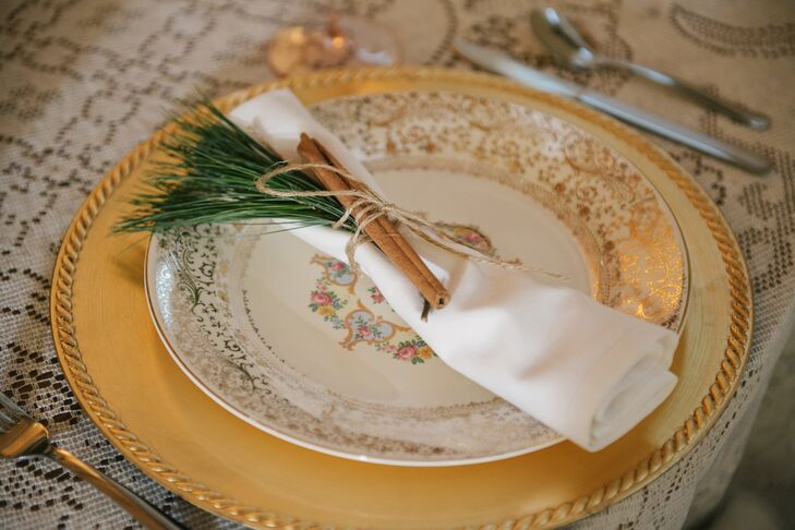 A family friend canvassed yard sales to find a variety of vintage plates, which were later topped with classic, white napkins tied with pine leaves and cinnamon sticks.