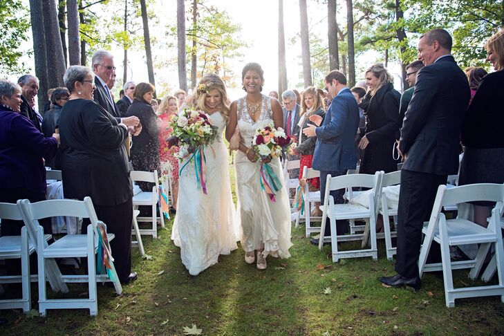 """Our wedding day was surreal,"" Laura says of their intimate outdoor nuptials. ""The morning was cloudy until the moment we walked down the aisle. The sun came out just for our ceremony!"""