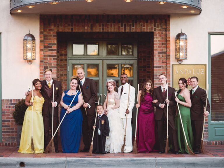 Harry Potter bridesmaids and groomsmen in the colors of each house. Hufflepuff, Ravenclaw, Griffyndor and Slytherin. All holding brooms instead of bouquets.