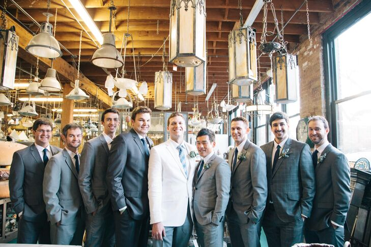 "The groom wore white, which popped against his groomsmen in classic gray suits. ""Rob wanted to wear white and I thought it was a great way to remind people that it's his day, too,"" Sarah says. ""Plus, it took some of the focus off of me!"""