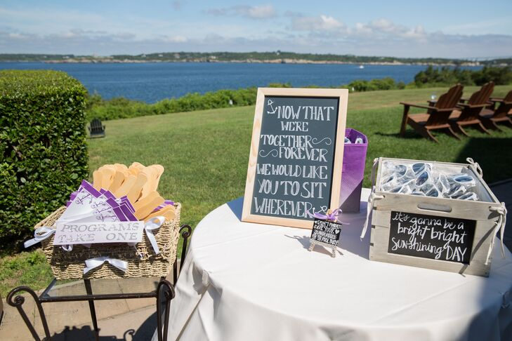 To make guests feel comfortable during the waterfront ceremony, Christina and Matt set up a welcome table at the entrance of the ceremony site filled with items, like sunglasses and fans, to help guests beat the summer heat.