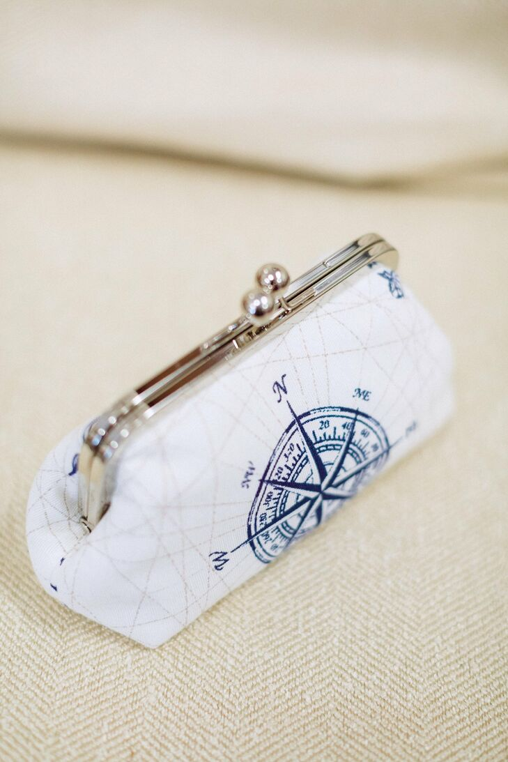 Amanda carried a small compass clutch, a nod to the marina location.