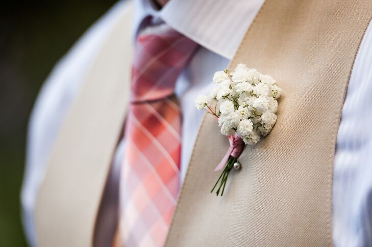 The groomsmen wore Baby's Breath boutonnieres.