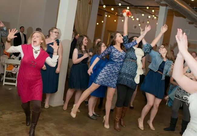 LOL! Guest Runs Away From The Bouquet Toss