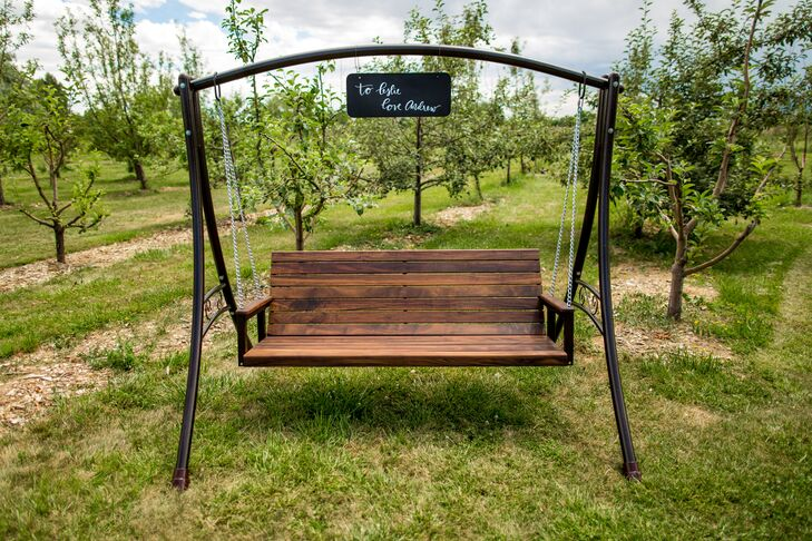 "Instead of a traditional wedding gift, Andrew made this gorgeous wooden swing for Leslie. ""It was so neat to receive it at the wedding where our guests could admire his handiwork,"" Leslie says. ""He loves me and showers me with beautiful handmade gifts."""