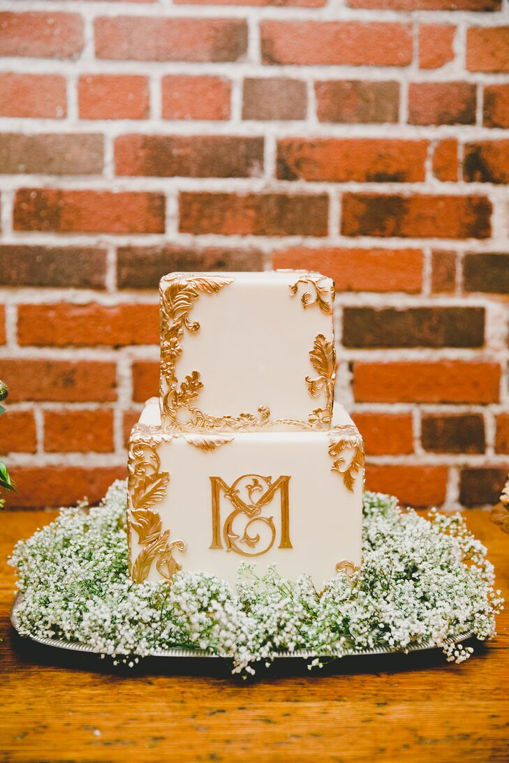 The main Funfetti cake from Sweet and Saucy bakery in Long Beach was made with ivory fondant and decorated with gold-leaf monogram and delicate Victorian accents.