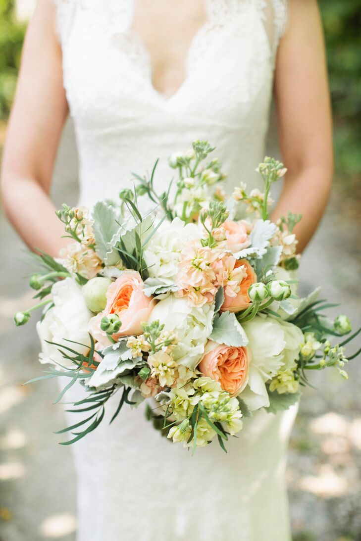 Jennifer Rose (owner at Salt Harbor Designs) chose the most beautiful flowers and fresh greens including ranunculus, spray roses, garden roses, stock and dusty miller. Nicole loved how the textured bouquet added personality to the classic wedding.