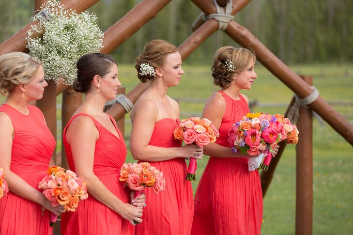 The bridesmaids wore orange J. Crew dress in the same color but different styles. rn