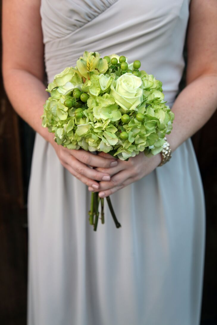 The bridesmaids carried lush green hydrangeas, roses, hypericum berries in their lush bouquets from Petals and Bells. Brooke and Brad loved how the flowers popped against the neutral gray bridesmaid dresses.