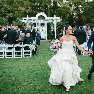 Bride and groom exiting their outdoor wedding ceremony