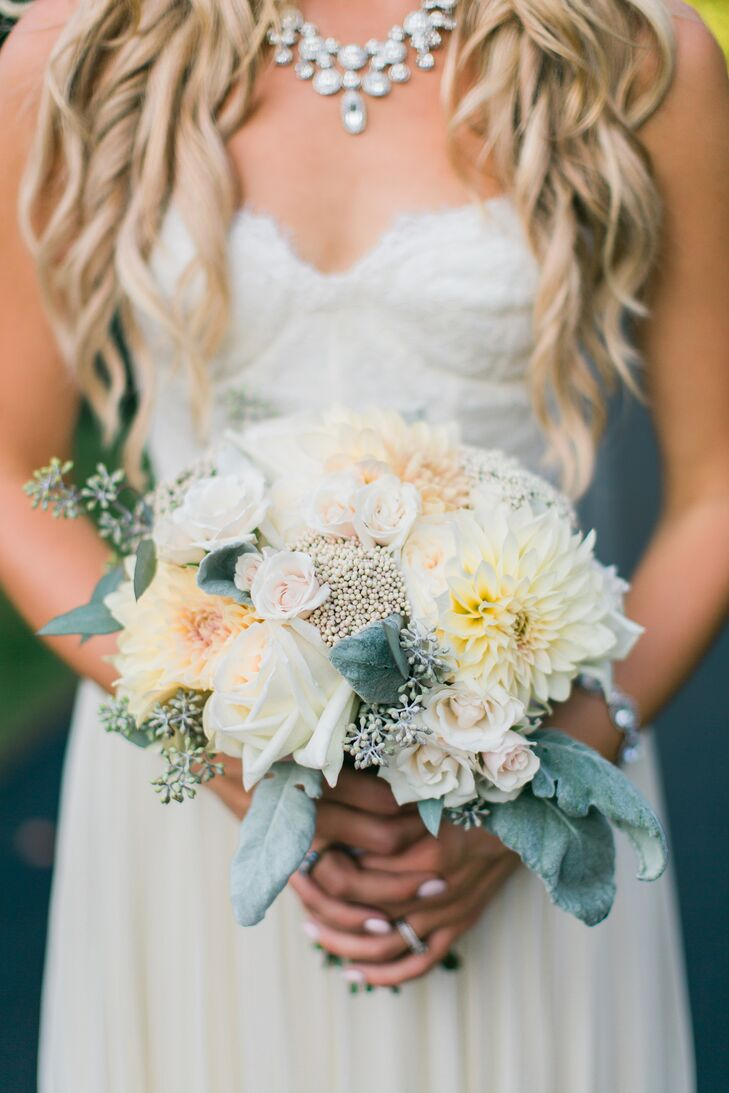 Amanda carried a compact bouquet of dahlias, roses, seeded eucalyptus and dusty miller, while bridesmaids carried dinner-plate dahlias.