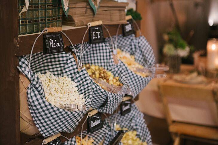 Taylor's grandfather created a custom popcorn bar for guests using wood, buckets and six flavors of the popped treat.