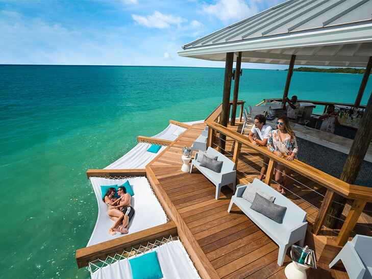 latitudes overwater bar at sandals southcoast resort in jamaica