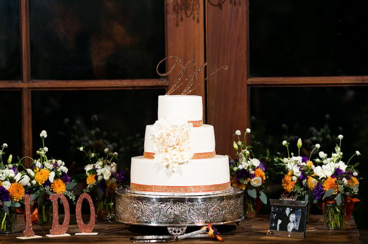 The three ivory tiers of wedding cake had gold wrapped around each base, and was positioned on top of a silver, elegant stand.