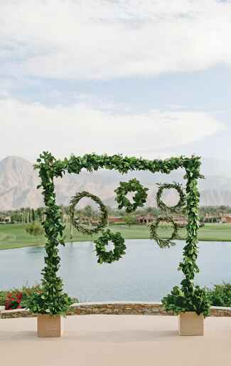 Unique wedding ceremony altar made of green garlands