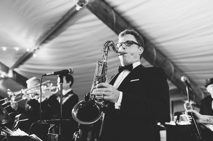 Chicago-based performers Ken Arlen Orchestra played Motown hits for guests during the couple's tented reception. During dinner, the band leader even surprised the bride by playing her favorite Beatles song, 'Blackbird'.