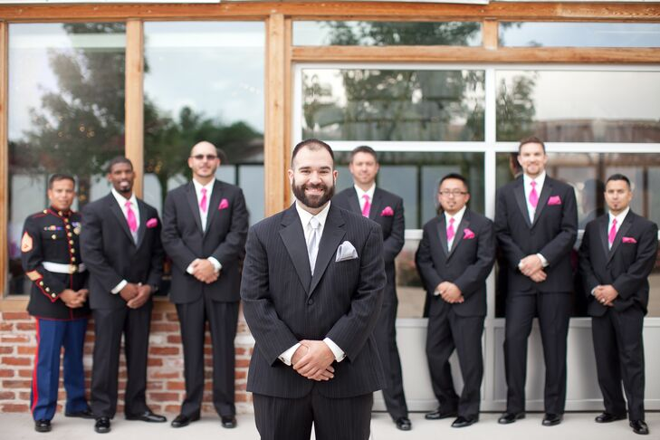 James wore a Calvin Klein pin-striped tuxedo with gray vest, tie and pocket square. The groomsmen wore black tuxedos from Men's Wearhouse pink ties and pocket squares to match the bridesmaid dresses.
