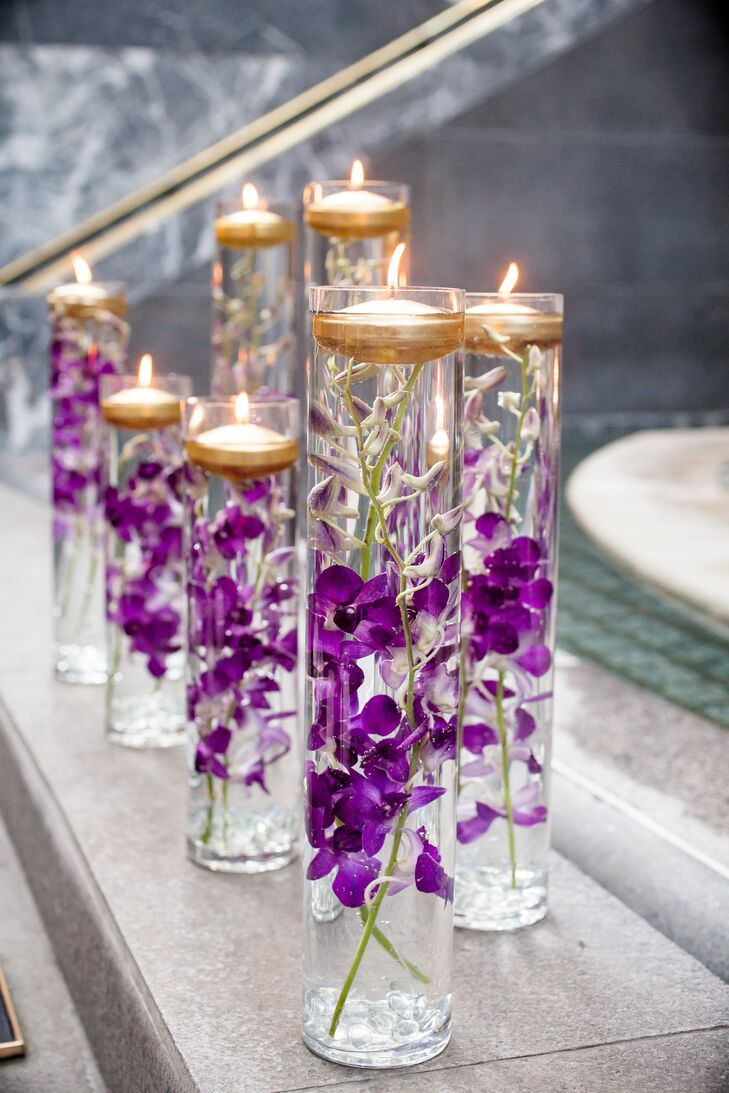 candle wedding decorations glass vases with purple orchids and floating candles 2429