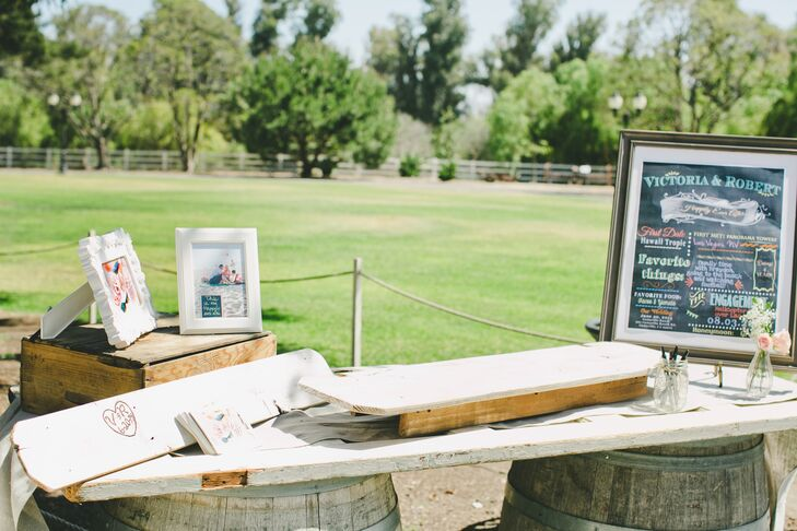 The plank that rested on wooden barrels created a table for the guest book alternative—two long pieces of wood where guests left lovely messages and advice for the newlyweds.