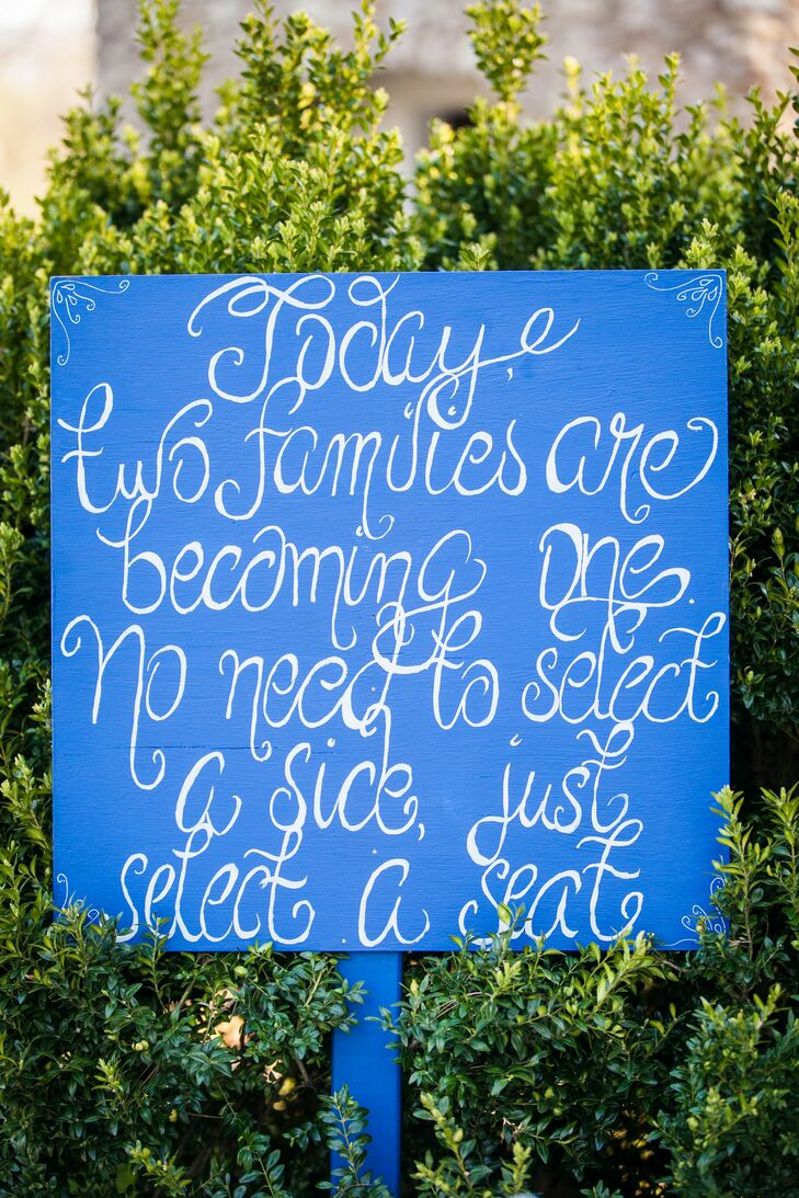 A blue hand-painted sign welcomed guests as they arrived to the ceremony, inviting the two families to mix and mingle.