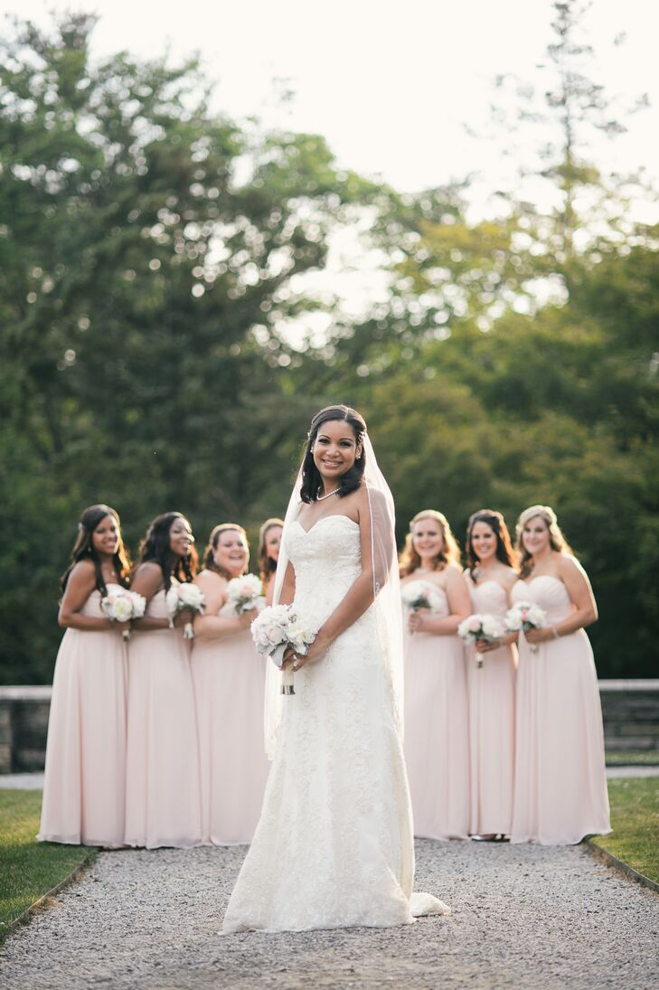 Nicole wore a strapless, beaded Martina Liana wedding dress and a fingertip veil. Her bridesmaids wore strapless, floor length dresses in blush chiffon.