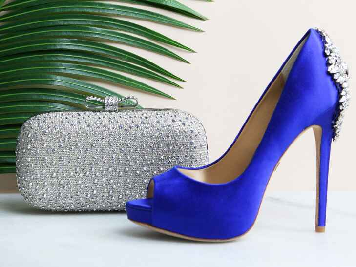 satin blue shoes and sparkly clutch