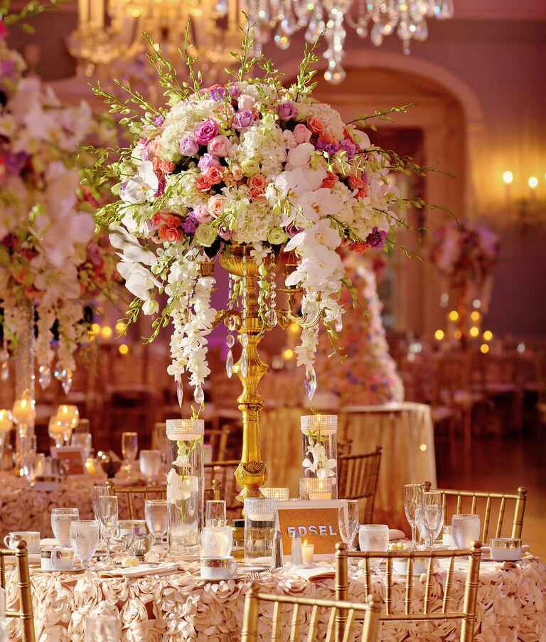 Glamorous wedding centerpiece of orchids and roses