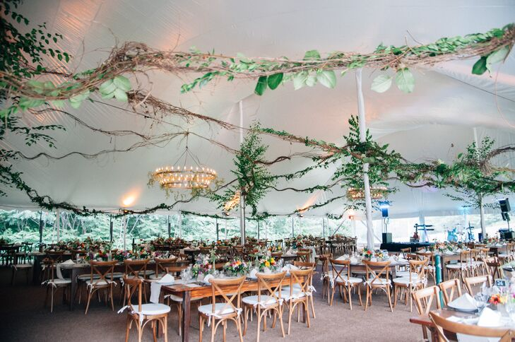 Lengths of rustic vines laced with fresh greenery stretched across the airy tent, giving the reception decor a whimsical, woodland feel while scaling down the decor to create an intimate, cozy backyard atmosphere.