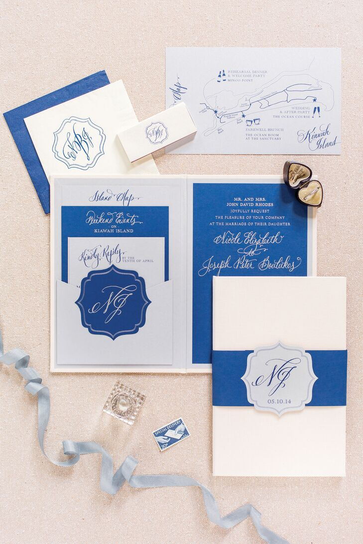 "The couple's crisp blue-and-cream invitation suit was entirely custom designed by Studio R. ""Our ceremony was outside overlooking the dunes and the water, so for the save-the-dates, we included a watercolor portrait of the ocean to tie in both the look and feel of the venue,"" Nicole says."