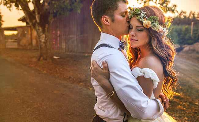 Audrey Roloff and Jeremy Roloff embrace during their wedding