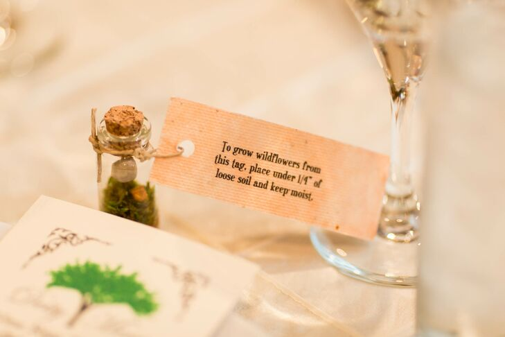 A subtle natural, organic theme carried throughout the decor, touching everything from Beth's bouquet to the centerpieces and even the favors. At each guests' seat, Beth and David placed a pint-sized vial of moss and stones to which they attached seed-paper tags, which could later be planted to grow wildflowers.