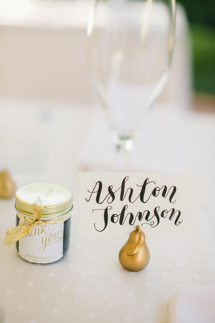 Since their wedding was in October, they wanted to match the garden setting with a few fall touches. Escort cards for their friends and family members were  held in gold pears. As for the nearby favors, nothing says autumn like jam. A gold thank-you card was attached to each one as they took home sweet, different-flavored jars from Kitchen Kettle Village as their gifts.