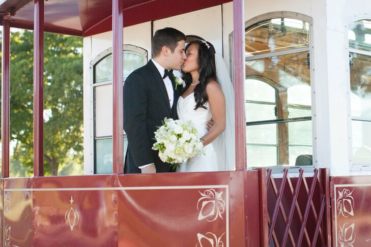 The couple paused for a kiss on the trolley that transported the bridal party from the hotel to the church.