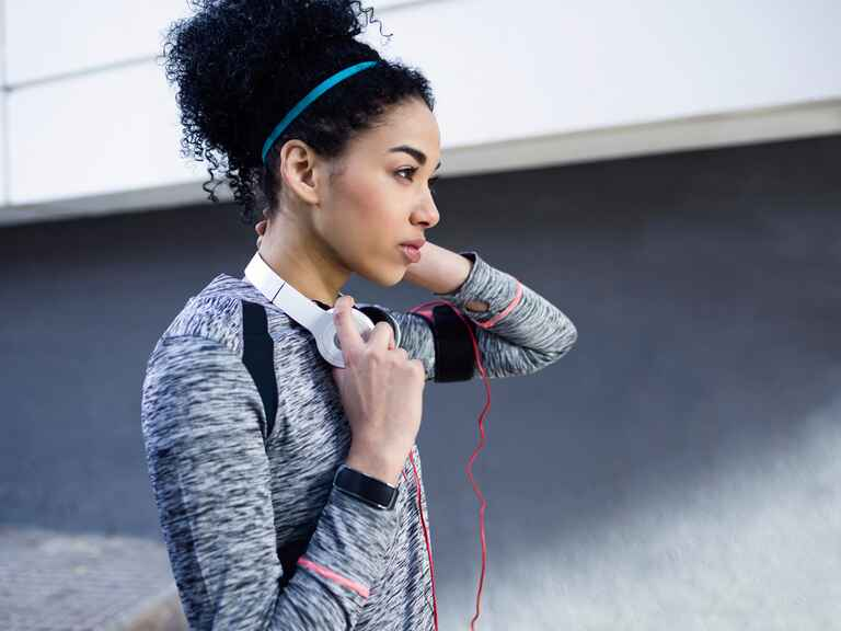 Woman working out with headphones