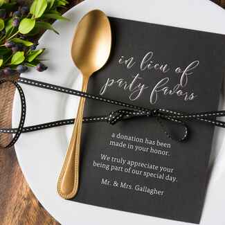 Place setting with donation in lieu of favors card
