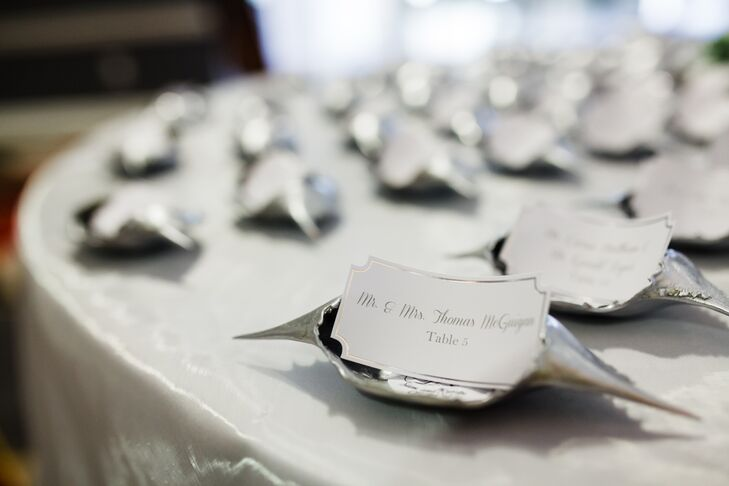 These silver crab shell table numbers were doubled as homemade ornaments that guests were able to take home as favors at the end of the night. They were also given shot glasses etched with the wedding label a friend had designed.