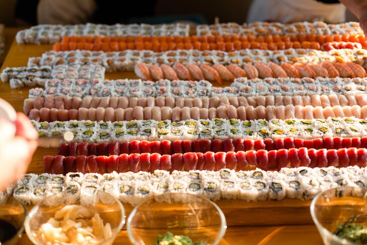 The bride and groom, avid foodies, provided guests with the ultimate spread at the sushi bar during the reception as a nod to their first date.