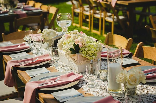 Tented reception with overflowing floral chandelier