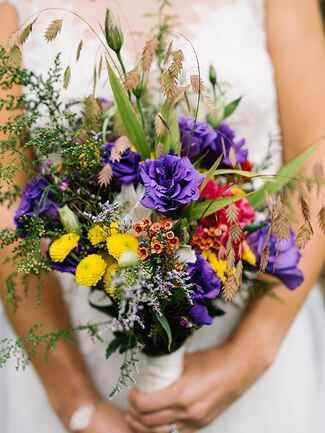 Colorful daisies and  lilly grass wildflower wedding  bouquet