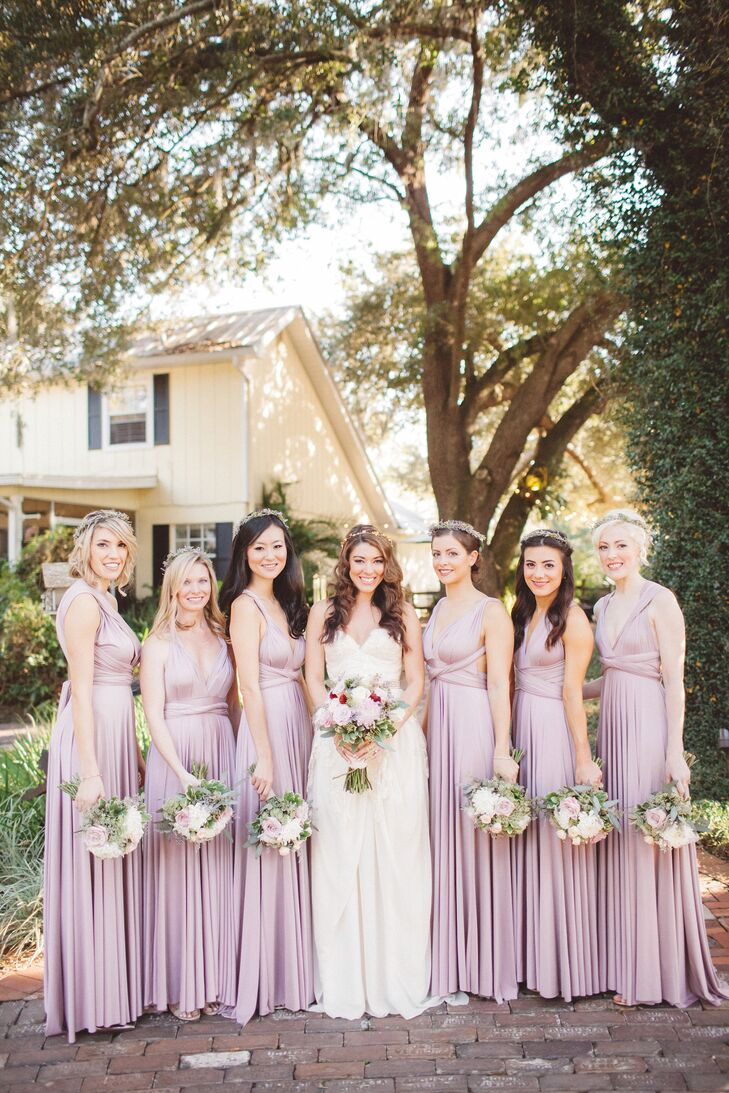 "Each bridesmaid wore a mauve floor-length dress from TwoBirds in New York, New York, that was chosen by Nikole's Maid of Honor. Her bridal party complemented the dress with a romantic flower crown, simple jewelry and either gold or nude shoes. ""I wanted them to look like fairies!"" says Nikole."