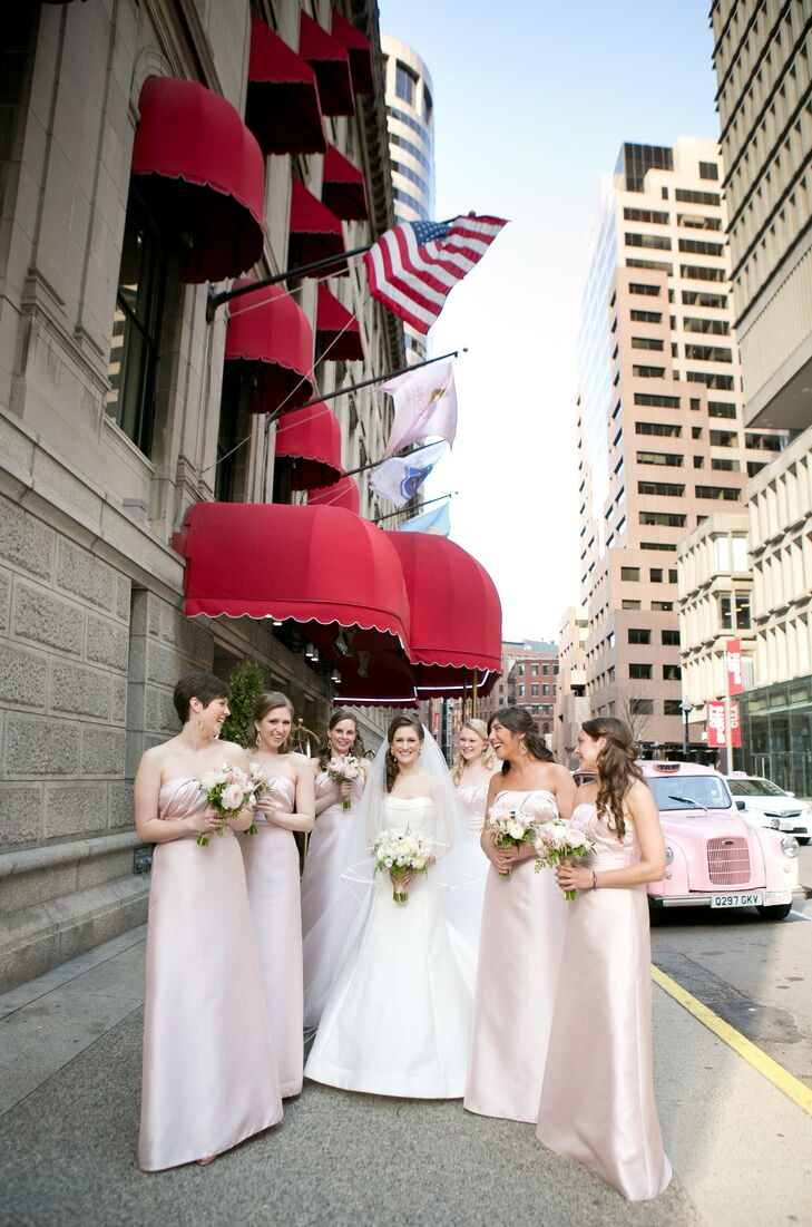 With their venue located in the heart of the city, Alexandra wanted a sophisticated, streamlined look for her bridesmaids. The girls wore matching floor-length gowns by Watters in a soft blush hue, gold shoes and gold drop earrings. On the day of the wedding, Alexandra had the girls style their hair into elegant half-up styles with loose romantic curls to complement her own side-swept 'do.