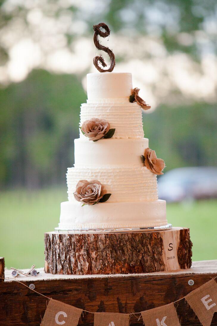 five-tier wedding cake with burlap flowers
