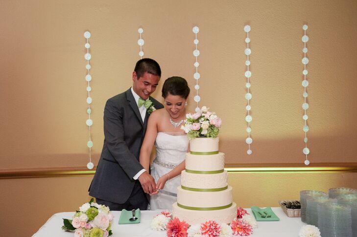 Married Couple Cutting Ivory Wedding Cake