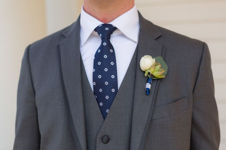The groomsmen's boutonniere included a peony bud and a succulent accented with aspen leaves.