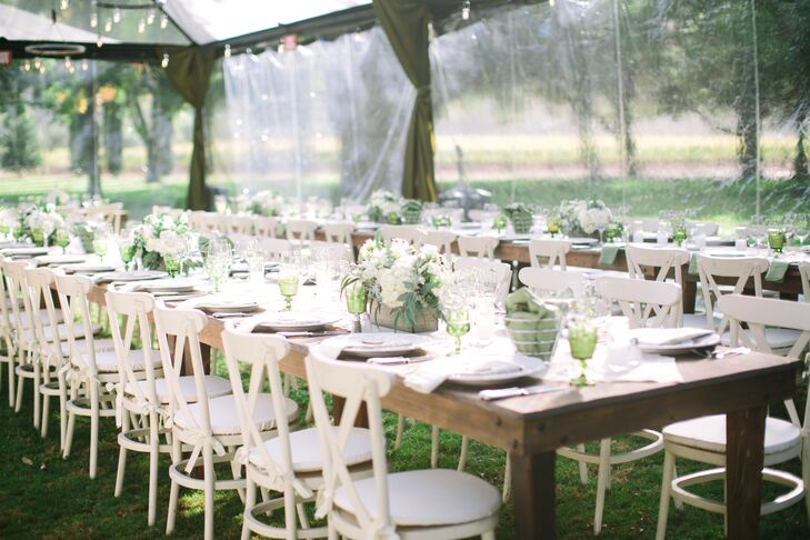 """I wanted the tables to look like someone (with impeccable taste) had pulled out their old dining room tables to the lawn and set up the most wonderful dinner for all of their closest friends,"" says Sloane. ""For that reason, we had long farmhouse tables and only a runner down the middle. Each table each had one large box of flowers with hydrangeas, olive leaves, ivy, white daisies, roses and ferns as a centerpiece."""
