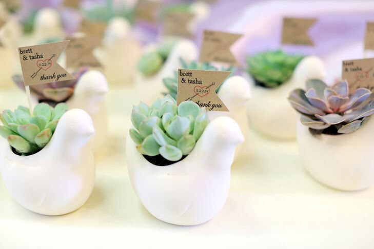 "The wedding favors were ceramic bird pots with a variety of succulents tucked inside. Each included a tag with the couple's names, wedding date and ""thank-you."""