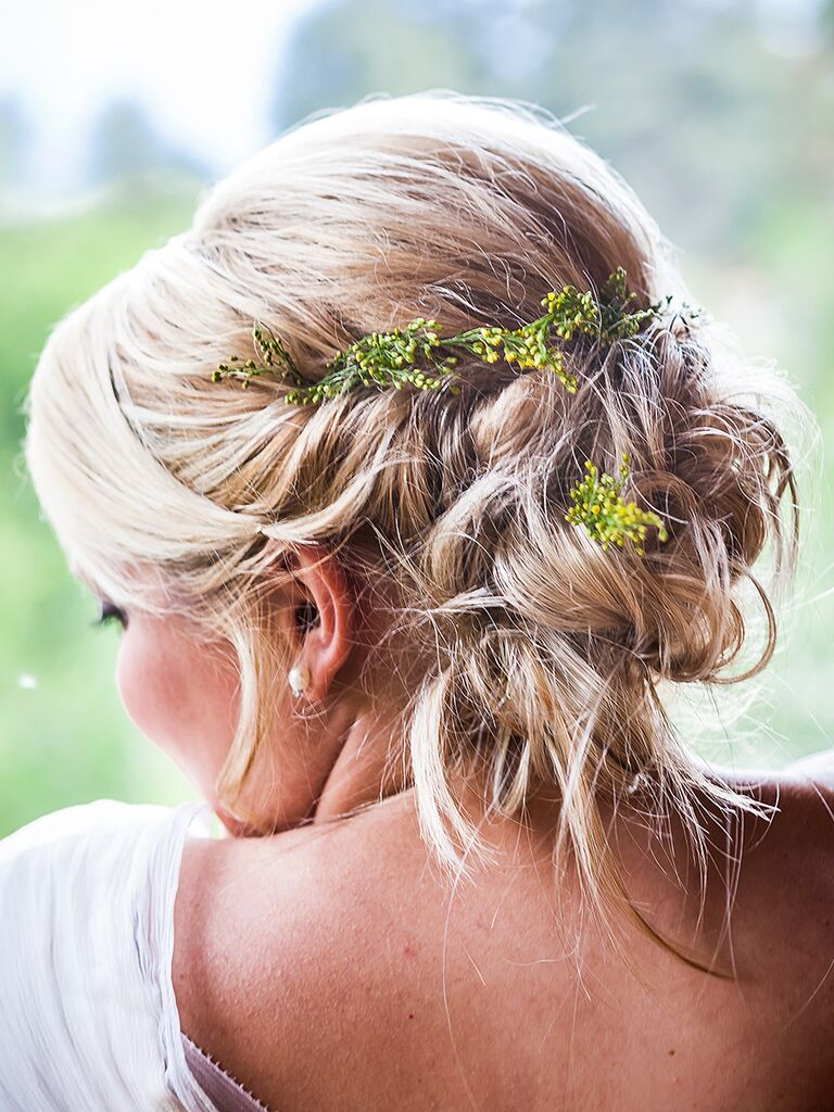 Messy wedding hairstyle with greenery